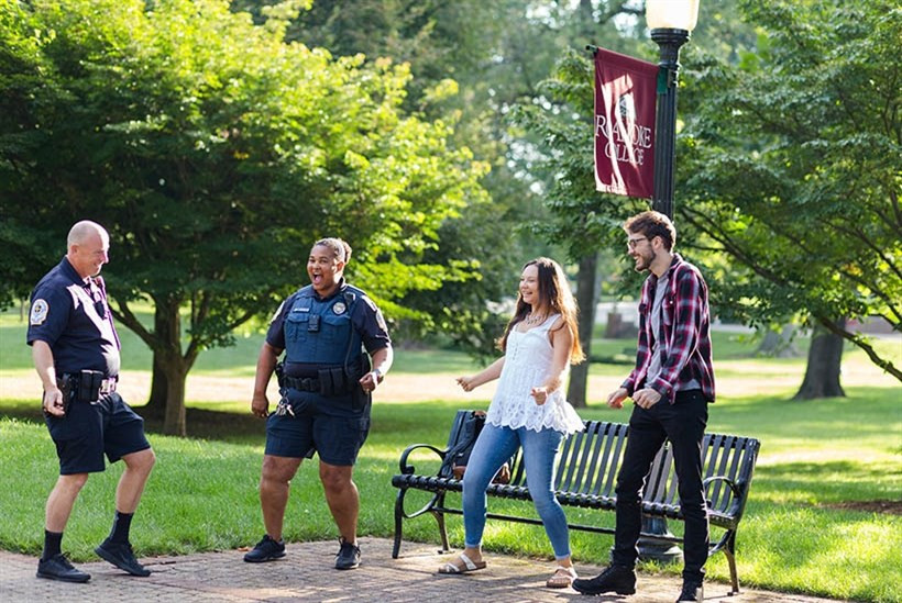 Students dancing with campus safety