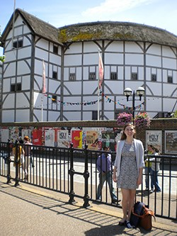 Student in front of the Globe Theater in london