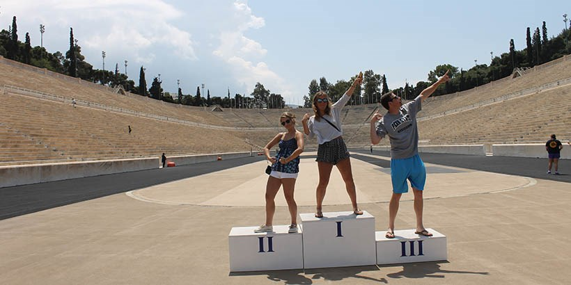 Students in the middle of an Olympic arena in Greece