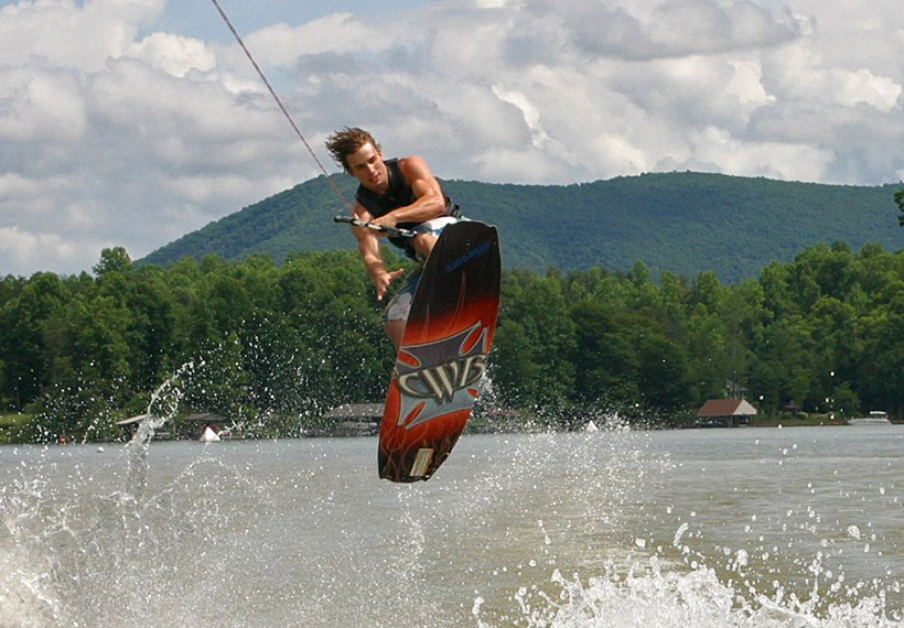 Student wakeboarding on a lake