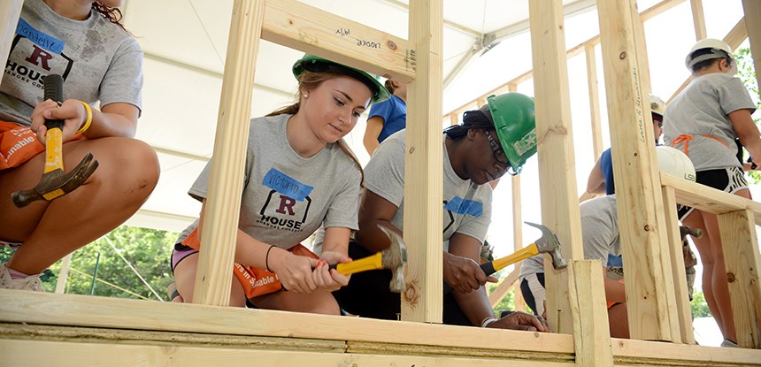 "Students building an house (""R""House) as part of orientation"