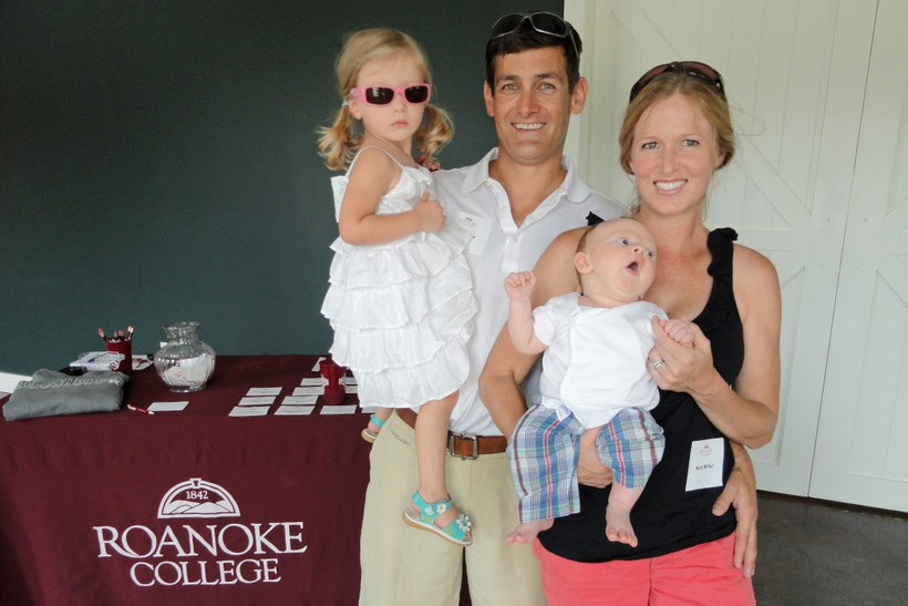 Two alumni with their two children at a Roanoke College event