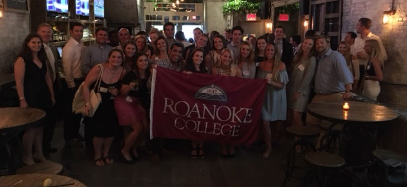 The New York Alumni chapter with the Roanoke College flag at a social event