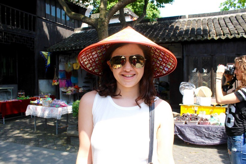 Student wearing an Asian conical hat