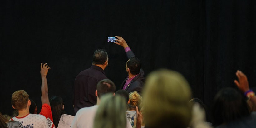 Jesse Jackson and Sam Rasoul take a selfie with audience members.
