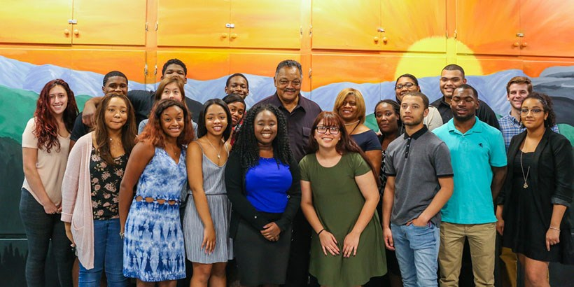 Students and staff pose for a photo with Jesse Jackson.