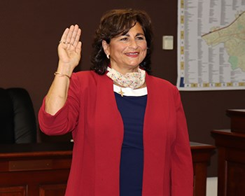 Woman takes oath of office