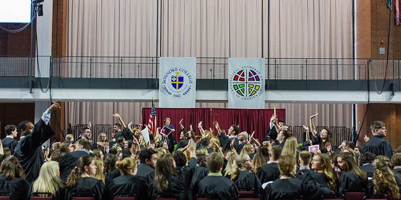 Students waving their hands in the air at Baccalaureate