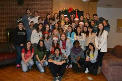 International students gathered together in a lounge for a picture